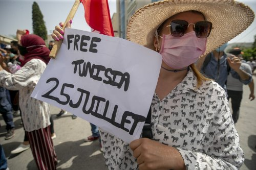 Tunisians stage a protest in response to the problems in the country in Tunis, Tunisia on 25 July 2021 [Yassine Gaidi/Anadolu Agency]