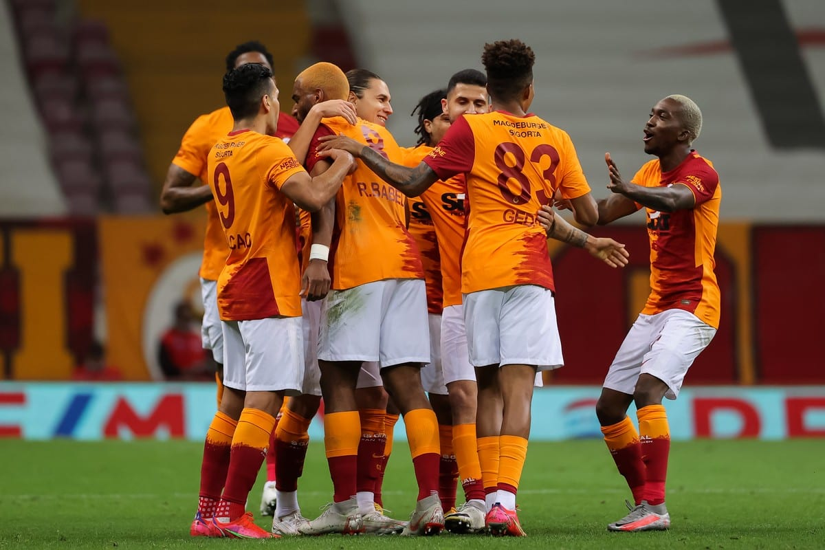 Players of the Galatasaray Football Club huddle together during a football match in Istanbul, Turkey on 8 May 2021 [BSR Agency/Getty Images]