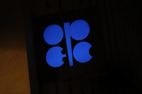 An OPEC sign hangs outside the OPEC Secretariat on December 6, 2018 [Stefan Wermuth/Bloomberg via Getty Images]