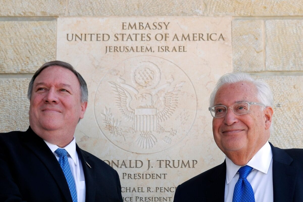 US Secretary of State Mike Pompeo (L) and US ambassador to Israel David Friedman stand next to the dedication plaque at the US embassy in Jerusalem on March 21, 2019 [JIM YOUNG/AFP via Getty Images]