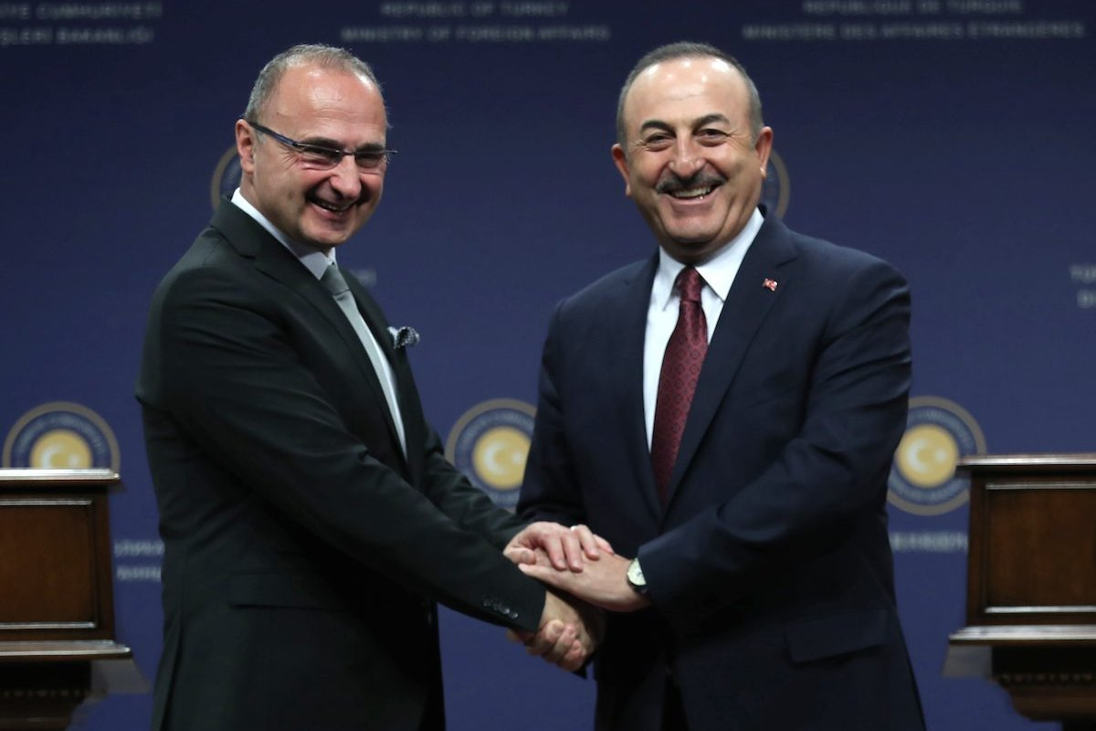 Croatia's Foreign and European Affairs Minister Gordan Grlic Radman (L) shakes hands with Turkish Foreign Minister of Turkey Mevlut Cavusoglu (R) prior to a press conference following their meeting in Ankara, on 11 December 2019. [ADEM ALTAN/AFP via Getty Images]