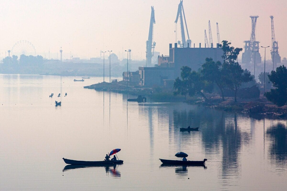 This picture taken on November 3, 2020 shows a general view of of fishermen in their boats by the main port of Maqil in Iraq's southern city of Basra overlooking the Shatt al-Arab river, formed by the confluence of the Euphrates and the Tigris [HUSSEIN FALEH/AFP via Getty Images]