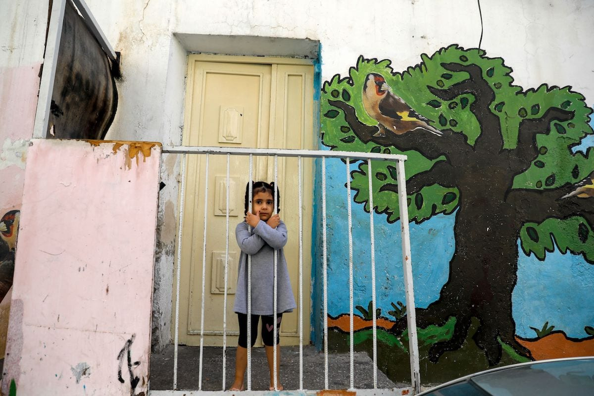 A Palestinian child is pictured in front of the family home in the predominantly Arab neighbourhood of Silwan in east Jerusalem, on 9 November 2020. [AHMAD GHARABLI/AFP via Getty Images]