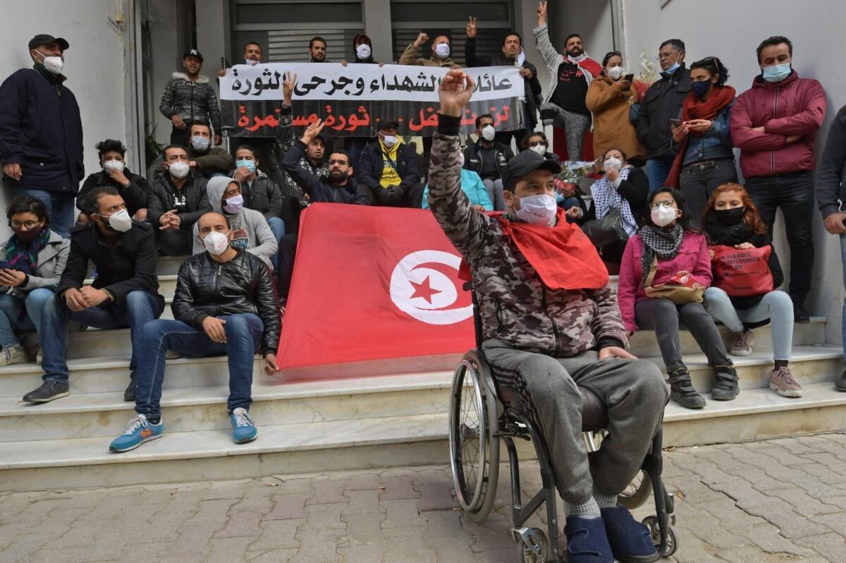 A Tunisian youth who was injured during the revolution shouts anti-government slogans during a sit in on January 14, 2021, in the capital Tunis [FETHI BELAID/AFP via Getty Images]