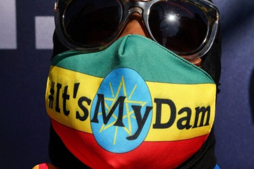 """Protestors march down 42nd Street in New York during a """"It's my Dam"""" protest on March 11, 2021 [TIMOTHY A. CLARY/AFP via Getty Images]"""