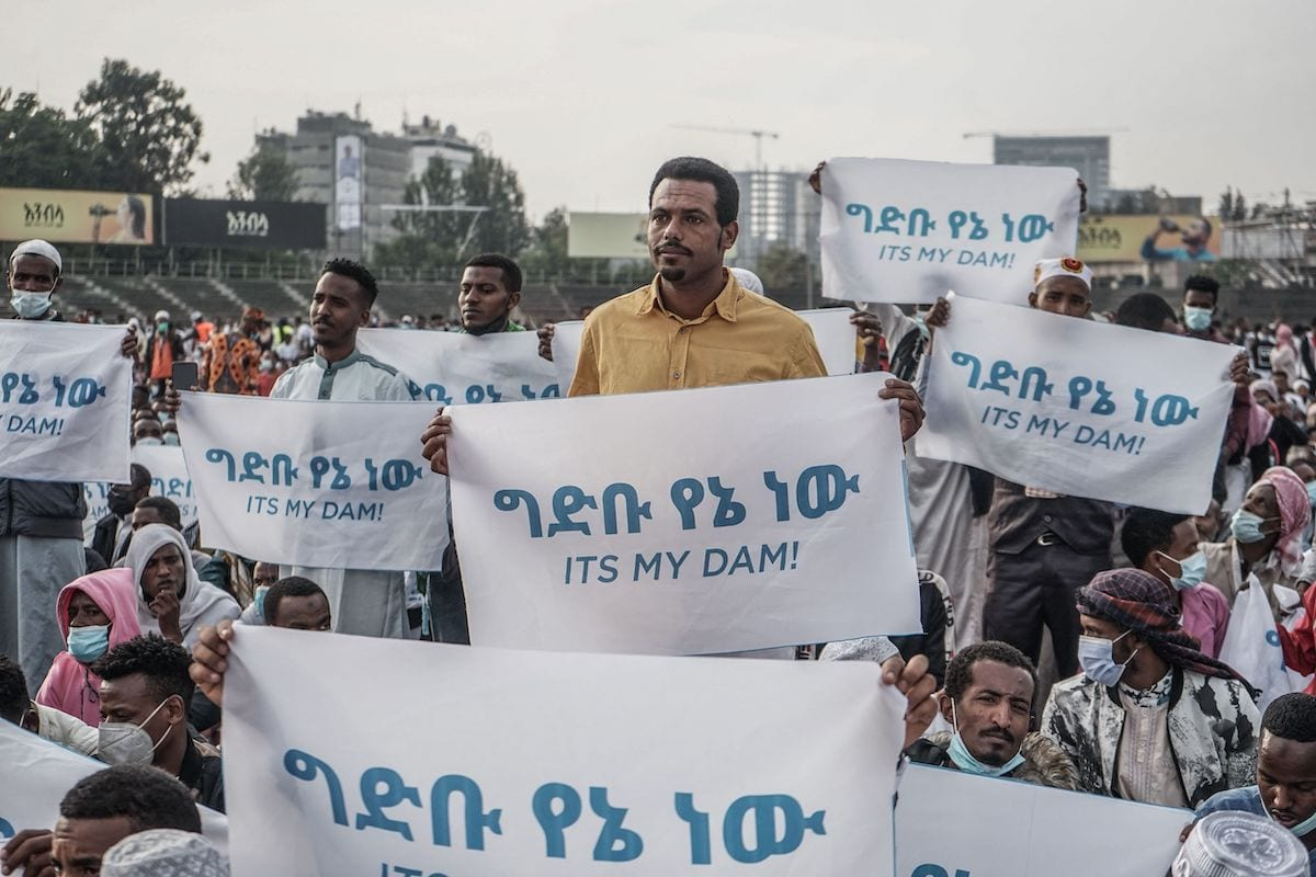 People hold placards to express their support for Ethiopia's mega-dam on the Blue Nile River in Addis Ababa, Ethiopia, on May 13, 2021 as Muslims across the globe mark the end of the Holy month of Ramadan. [AMANUEL SILESHI/AFP via Getty Images]