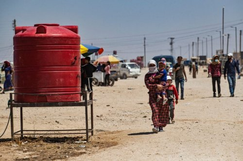 Syrians, displaced from Ras al-Ain, a border town controlled by Turkey on June 28, 2021 [DELIL SOULEIMAN/AFP via Getty Images]