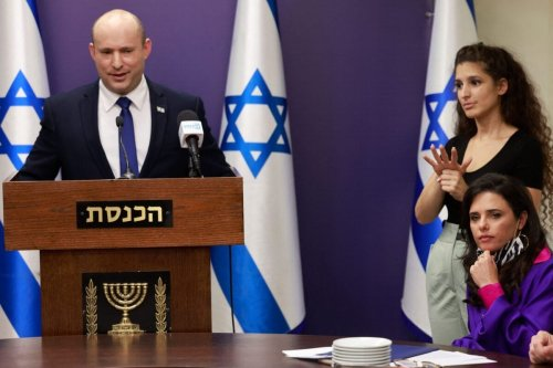 Israeli Prime Minister Naftali Bennett (L) gives a statement as Interior Minister Ayelet Shaked (R below) looks on at the Knesset in Jerusalem on July 5, 2021 [MENAHEM KAHANA/AFP via Getty Images]