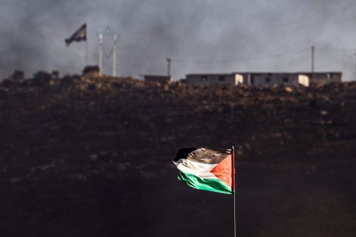 A Palestinian flag flies in the town of Beita, near the occupied West Bank city of Nablus, opposite the newly-established Israeli wildcat settler outpost of Evyatar on July 6, 2021 [JAAFAR ASHTIYEH/AFP via Getty Images]