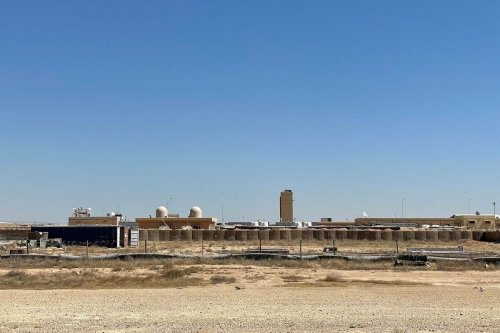 This picture taken on July 8, 2021 shows a view of the Ain al-Assad air base hosting US forces in Iraq in the western Anbar province, a day after fourteen rockets were fired at the base. [AYMAN HENNA/AFP via Getty Images]