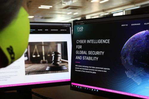 A woman checks the website of Israel-made Pegasus spyware at an office in the Cypriot capital Nicosia on July 21, 2021. [MARIO GOLDMAN/AFP via Getty Images]