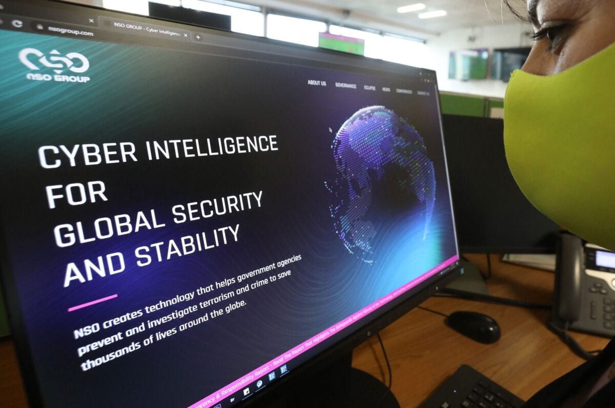 """A woman checks the website of Israel-made Pegasus spyware at an office in the Cypriot capital Nicosia on July 21, 2021. - Reports that Israel-made Pegasus spyware has been used to monitor activists, journalists and politicians around the world highlight the diplomatic risks of nurturing and exporting """"oppressive technology"""", experts warned. Private Israeli firm NSO Group has denied media reports its Pegasus software is linked to the mass surveillance of journalists and rights defenders, and insisted that all sales of its technology are approved by Israel's defence ministry. (Photo by Mario GOLDMAN / AFP) (Photo by MARIO GOLDMAN/AFP via Getty Images)"""