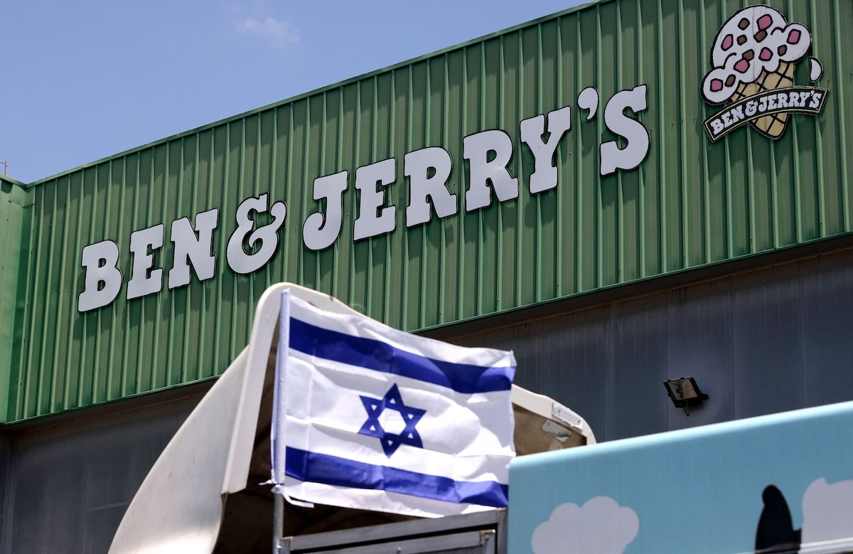 An Israeli flag is set atop a delivery truck outside US ice-cream maker Ben & Jerry's factory in Be'er Tuvia, on 21 July 2021. [EMMANUEL DUNAND/AFP via Getty Images]