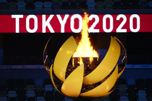 The Olympic Flame burns after the lighting of the Olympic Cauldron during the opening ceremony of the Tokyo 2020 Olympic Games, at the Olympic Stadium, in Tokyo, on July 23, 2021 [FRANCK FIFE/AFP via Getty Images]