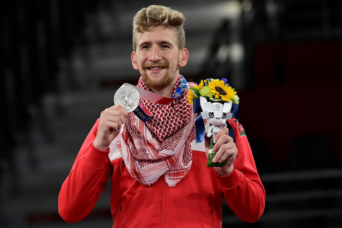 Silver medalist Jordan's Saleh Elsharabaty poses on the podium after the taekwondo men's -80kg bouts during the Tokyo 2020 Olympic Games at the Makuhari Messe Hall in Tokyo on 26 July 2021. [JAVIER SORIANO/AFP via Getty Images]