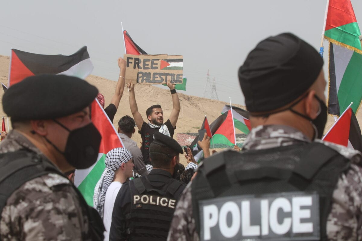 Thousands of young Jordanians arrive for a mass march near the border with Israel in solidarity with the Palestinians on May 21, 2021 in al-Karama, Jordan [Jordan Pix/Getty Images]