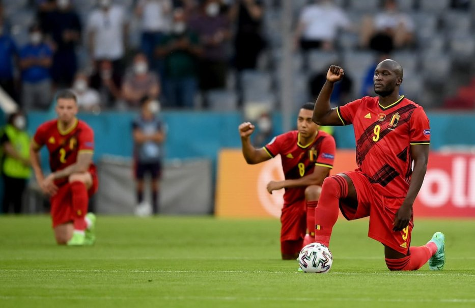 Romelu Lukaku of Belgium takes a knee to support the Black Lives Matter movement ahead of the UEFA Euro 2020 Championship quarter-final match between Belgium and Italy at Football Arena Munich on July 2, 2021 in Munich, Germany. [Matthias Hangst/Getty Images]
