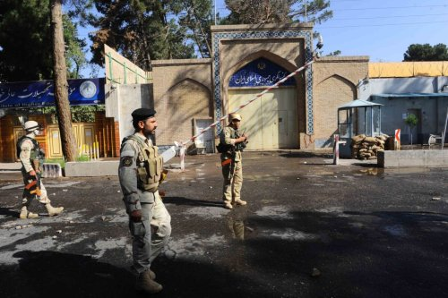 Afghan security personnel stand guard in front of the Iranian consulate on September 7, 2013 [Aref Karimi/AFP via Getty Images]