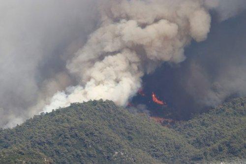 Smoke rises after a forest fire broke out in Marmaris district in Mugla, Turkey on July 31, 2021 [Ali Rıza Akkır/Anadolu Agency]