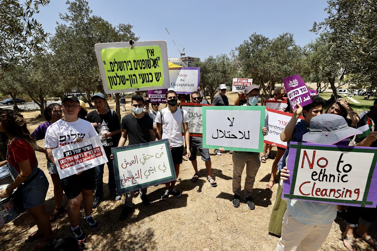 Palestinians stage a protest in front of the Supreme Court of Israel after the court's postponed its decision on the objection of the Palestinian families on forced eviction in Sheikh Jarrah Neighborhood in Jerusalem on 2 August 2021. [Mostafa Alkharouf - Anadolu Agency]