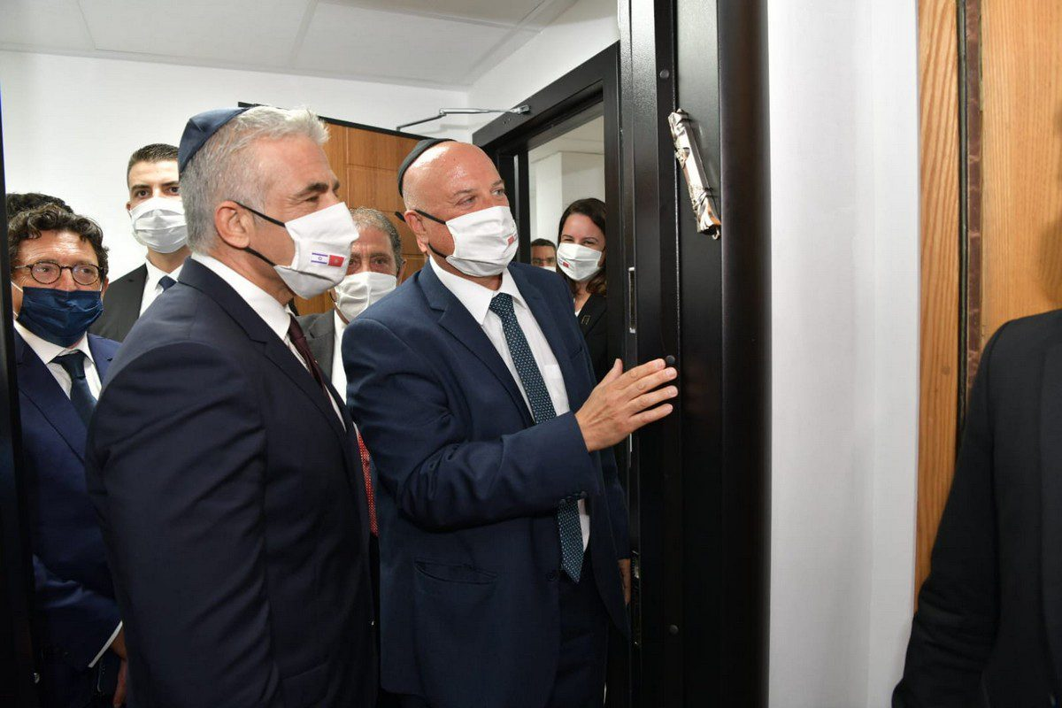 Israeli Foreign Minister Yair Lapid (L) attends the opening ceremony of the diplomatic mission office with the attendance of Israel interim Chief of Diplomatic Mission in Morocco, Ambassador David Govrin (R) in Rabat, Morocco on 12 August 2021. [Israeli Foreign Ministry / Handout - Anadolu Agency]