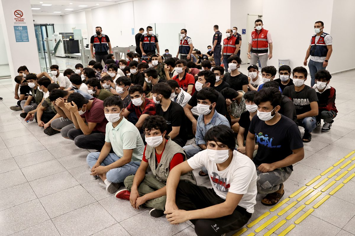 ISTANBUL, TURKEY - AUGUST 13: Afghan irregular migrants, taken to the repatriation centre for procedures, are seen at Istanbul Airport to be deported in Istanbul, Turkey on August 13, 2021. ( İslam Yakut - Anadolu Agency )