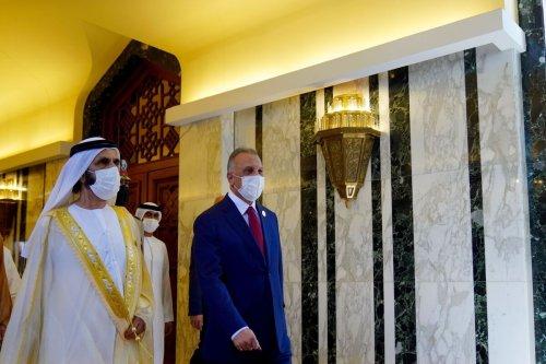 Vice President of the United Arab Emirates Mohammed bin Rashid Al Maktoum [left] is welcomed by Iraqi Prime Minister Mustafa Al-Kadhimi at Baghdad Airport in Baghdad, Iraq on August 28, 2021 [Iraqi PM Press Office / Anadolu Agency]