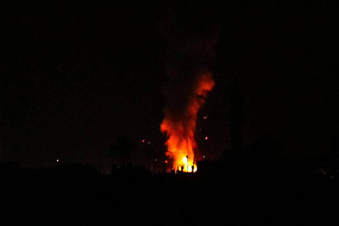 Explosion illuminates the night sky after Israeli warplanes hit a target of Izz ad-Din al Qassam Brigades, the armed wing of Palestinian group Hamas, and an agricultural area in Gaza City, Gaza on August 28, 2021 [Ali Jadallah/Anadolu Agency]