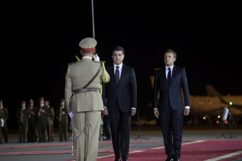 French President Emmanuel Macron (R) is welcomed by Iraqi Kurdish Regional Government's (IKRG) President Nechirvan Barzani (2nd R) upon his arrival at Erbil Airport in northern Iraq on August 29, 2021 [Ahsan Mohammed Ahmed Ahmed/Anadolu Agency]