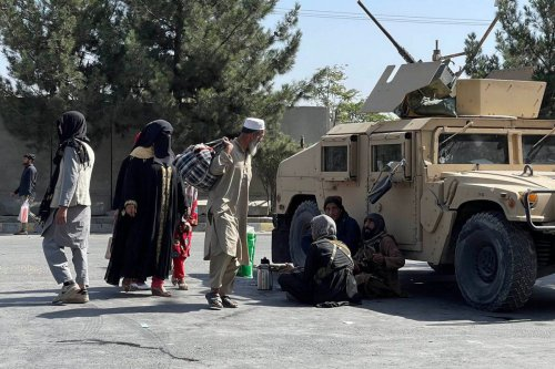 Taliban members stand guard at a checkpoint in Kabul, Afghanistan on 27 August 2021 [Haroon Sabawoon/Anadolu Agency]
