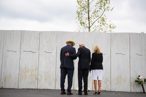 President Joe Biden and his wife, Jill, with Calvin Wilson after laying a wreath on the Wall of Names following a ceremony at the Flight 93 National Memorial commemorating the Anniversary of the crash of Flight 93 and the September 11th terrorist attacks on September 11, 2020 in Shanksville, Pennsylvania [Jeff Swensen/Getty Images]