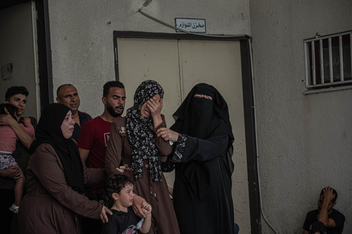 Relatives of Palestinian Hashem al-Shorafa, who was killed during an israeli raid on North Gaza City, mourn during his funeral on 20 May 2021 in Gaza City, Gaza. [Fatima Shbair/Getty Images]