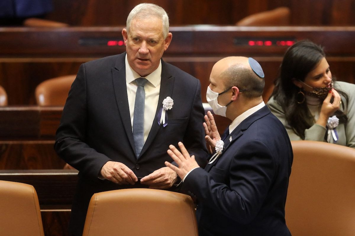 srael's Defence Minister Benny Gantz (L) and Prime Minister Naftali Bennett speak to each other at a Knesset (parliament) meeting during which Isaac Herzog, a veteran of Israel's left-wing Labor party, was sworn in as the Jewish state's 11th president, replacing Reuvin Rivlin, in Jerusalem, on 7 July 2020. [GIL COHEN-MAGEN/AFP via Getty Images]
