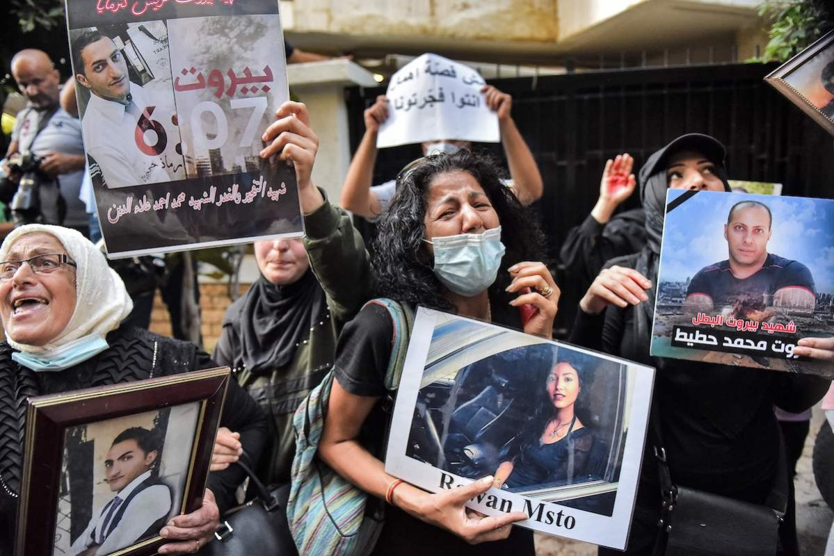 Demonstrators and families of the Beirut blast victims chant slogans during a protest outside the residence of Lebanon's Interior Minister in the Qoraitem neighbourhood of western Beirut on 13 July 2021. [AFP via Getty Images]