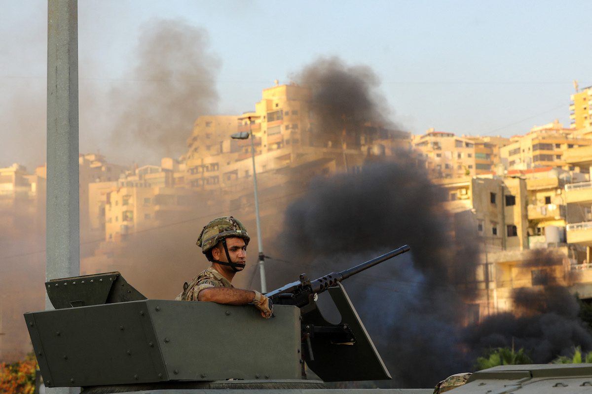 A Lebanese soldier sits in an armoured vehicle as the army deploys amid clashes in the Khalde area, south of the capital, on 1 August 2021. [ANWAR AMRO/AFP via Getty Images]