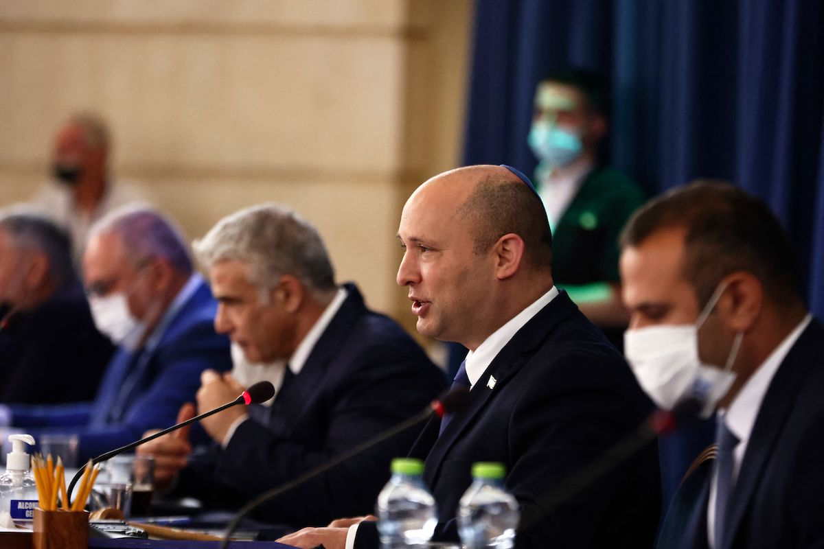 Israeli Prime Minister Naftali Bennett (2nd R) speaks at the weekly cabinet meeting at the Foreign Ministry in Jerusalem on 8 August 2021. [RONEN ZVULUN/POOL/AFP via Getty Images]