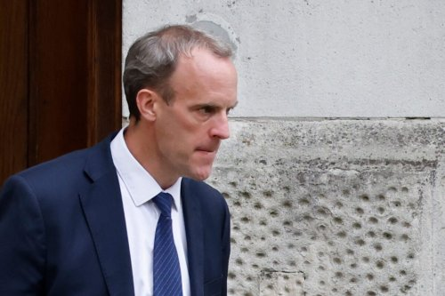 Britain's Foreign Secretary Dominic Raab leaves the Foreign, Commonwealth and Development Office headed for Downing Street in central London on August 20, 2021. - Britain's Foreign Secretary Dominic Raab on August 20 defied demands to quit after failing to make a telephone call to help translators fleeing Afghanistan, saying the Taliban's rapid advance made contact impossible. (Photo by Tolga Akmen / AFP) (Photo by TOLGA AKMEN/AFP via Getty Images)