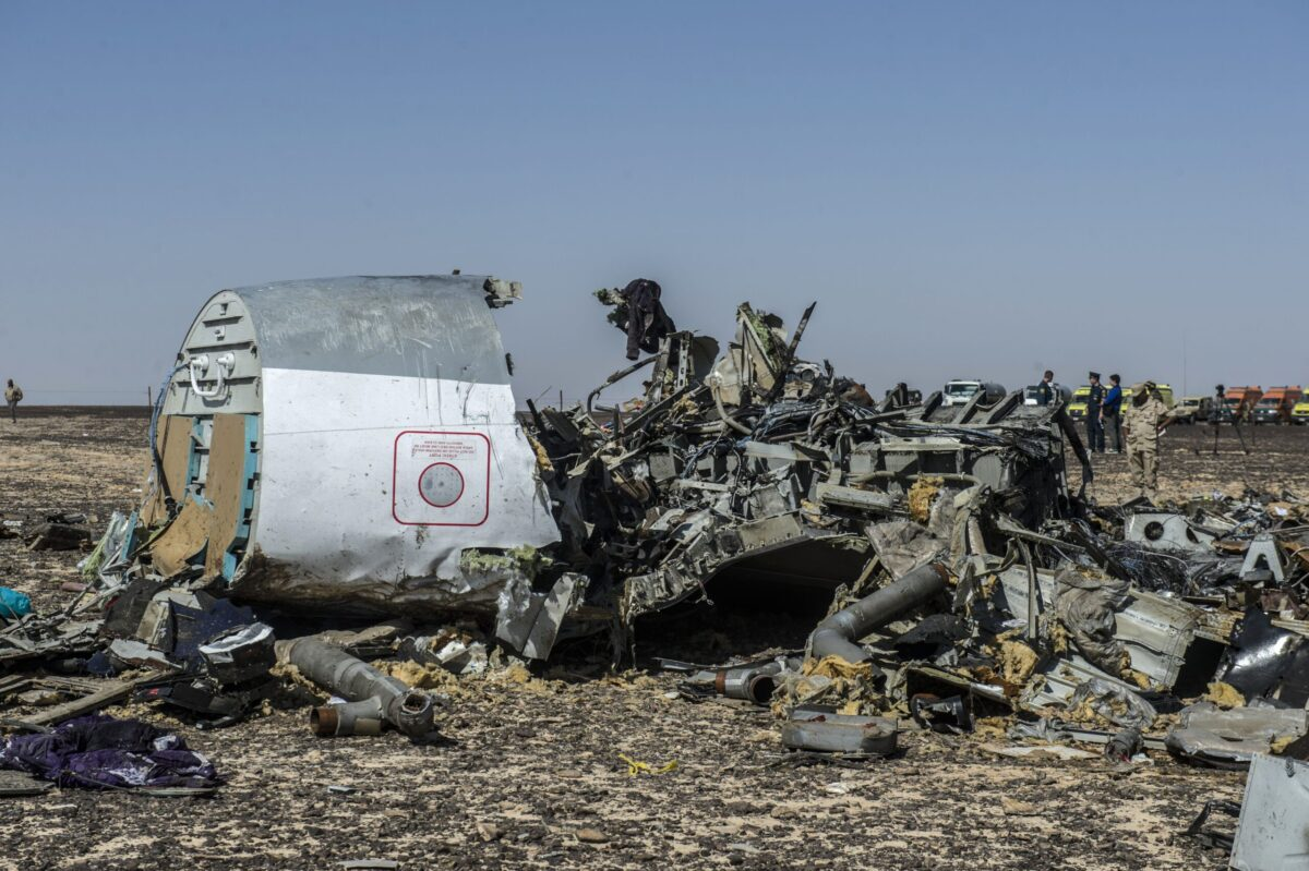 Debris of the A321 Russian airliner lie on the ground a day after the plane crashed in Wadi al-Zolomat, a mountainous area in Egypt's Sinai Peninsula, on November 1, 2015. International investigators began probing why the Russian airliner carrying 224 people crashed in the Sinai Peninsula, killing everyone on board, as rescue workers widened their search for missing victims. AFP PHOTO / KHALED DESOUKI / AFP / KHALED DESOUKI (Photo credit should read KHALED DESOUKI/AFP via Getty Images)
