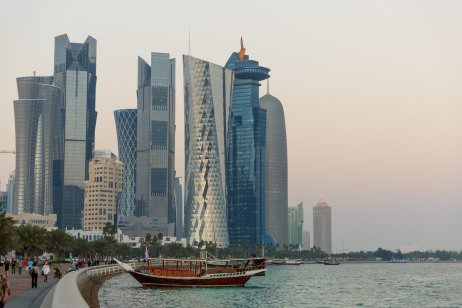 Views of the skyscraper skyline in Doha City, on the Corniche in Doha Bay. The county of Qatar will play host to the FIFA World Cup in 2022. [Matthew Ashton - AMA via Getty Images]