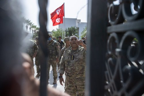 Tunisian forces take security measures around parliament during a protest against suspending parliament, in Tunis, Tunisia on 26 July 2021 [Nacer Talel/Anadolu Agency]