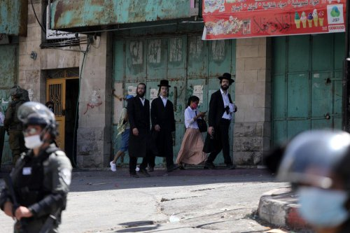 Israeli forces seen in Hebron as part of the Jewish holiday of Sukkot in the West Bank on 22 September 2021 [Mamoun Wazwaz/Anadolu Agency]