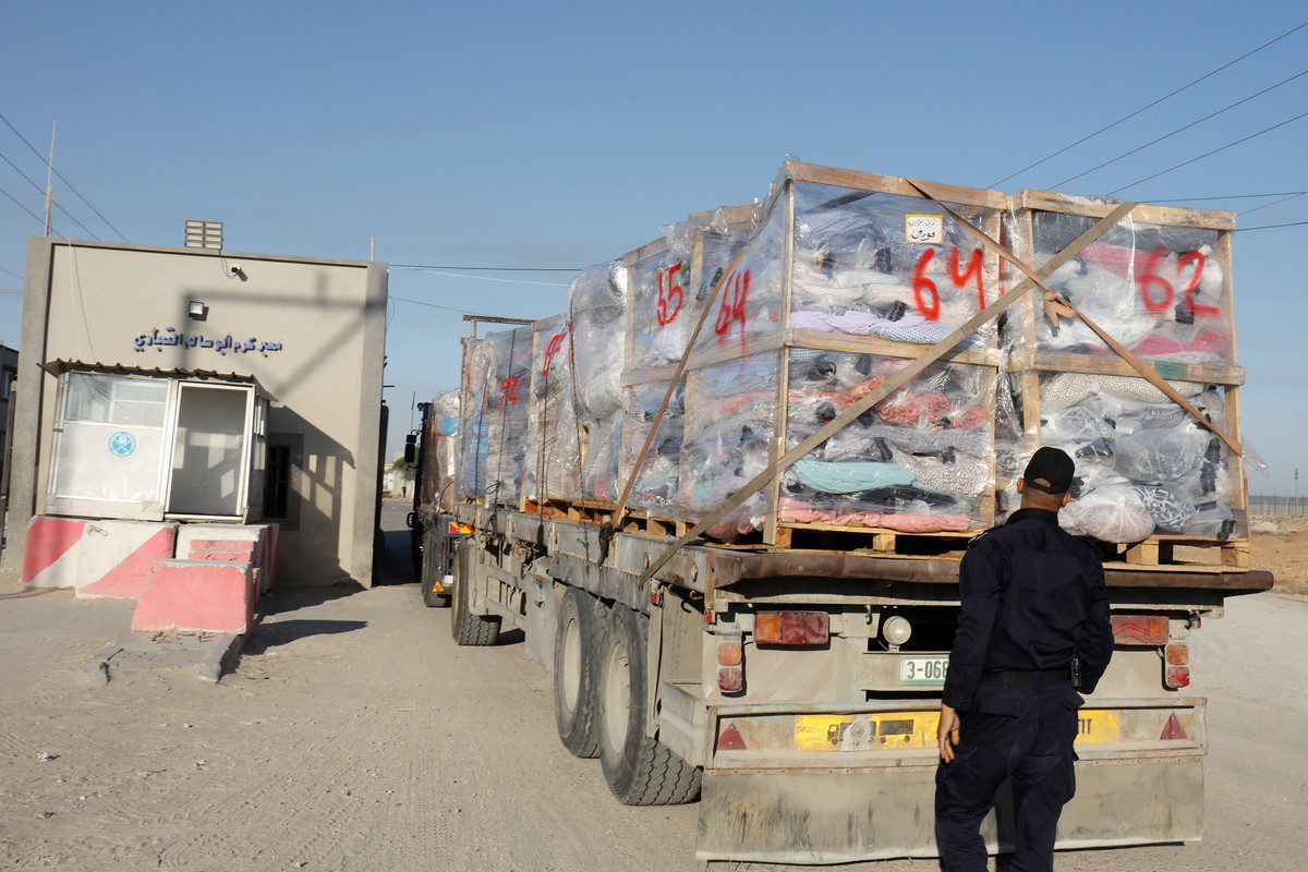 Trucks loaded with cargo for export at the Karm Abu Salem (Kerem Shalom) crossing in Gaza on 21 June 2021 [Abed Deeb/ApaImages]