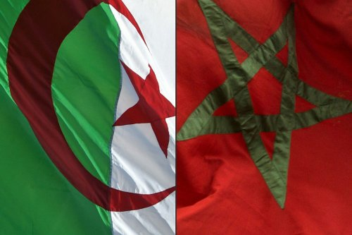The flags of Algeria (L) and Morocco, 27 August 2021 [RYAD KRAMDI,FADEL SENNA/AFP/Getty Images]