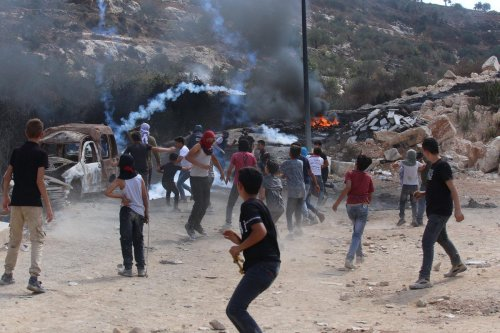 NABLUS, WEST BANK - SEPTEMBER 17: Palestinians respond to Israeli soldiers' intervention in Palestinians protesting against building and expanding of Jewish settlements in Beita district of West Bank's Nablus on September 17, 2021. ( Nedal Eshtaya - Anadolu Agency )