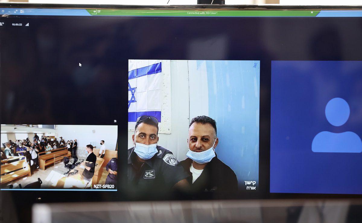 The hearing of Zakaria Zubeidi, Mahmoud al-Arida, Yakub Qaderi, and Mohammad Al-Arida held via video conference in Nazareth, Israel on 19 September 2021. Six Palestinian inmates had tunneled out of the high-security Gilboa Prison in northern Israel on Sept. 6. [Mostafa Alkharouf - Anadolu Agency]
