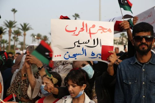 """Thousands of Libyans stage a protest against the """"withdrawal the vote of confidence from the government"""" decision of the House of Representatives (TM), chaired by warlord Khalifa Haftar's political ally Akile Salih, at Martyrs' Square in Tripoli, Libya on 24 September 2021. [Hazem Turkia - Anadolu Agency]"""