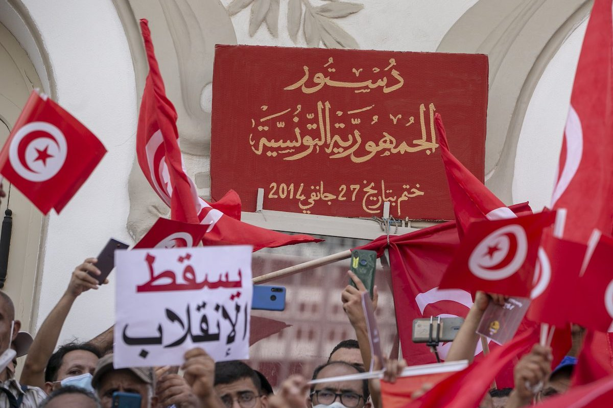 People stage a protest against the extraordinary decisions of President Kays Said in front of the Municipal Theater building on Habib Bourguiba Avenue in Tunis, Tunisia on September 26, 2021 [Yassine Gaidi/Anadolu Agency]