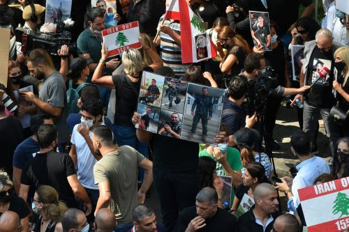 People gather in front of Ministry of Justice to protest against the dismissal of Judge Tarek Bitar, who conducted the investigation into the port explosion in Beirut, Lebanon on 29 September 2021 [Hussam Shbaro/Anadolu Agency]
