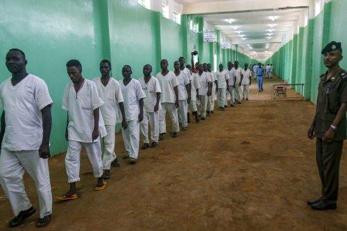 Sudanese prisoners al-Huda prison in the capital Khartoum's twin city of Omdurman on July 4, 2019 [ASHRAF SHAZLY/AFP via Getty Images]