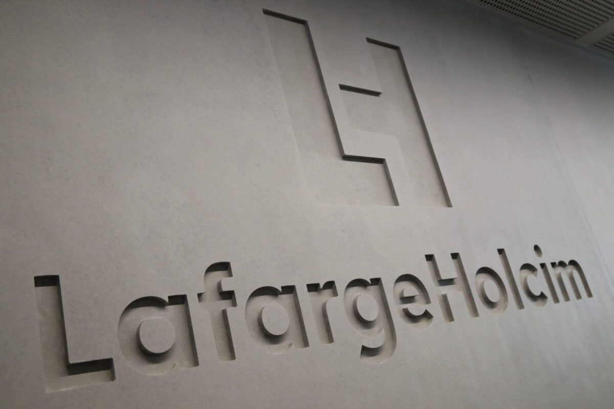 A relief logo sits in the wall at the LafargeHolcim Ltd. headquarters in Zug, Switzerland, on Tuesday, Sept. 3, 2019. After two painful years of restructuring, LafargeHolcim Chief Executive Officer Jan Jenisch says the worlds biggest maker of building materials is finally ready for acquisitions again -- as long as they don't threaten the progress he's made so far. Photographer: Stefan Wermuth/Bloomberg via Getty Images